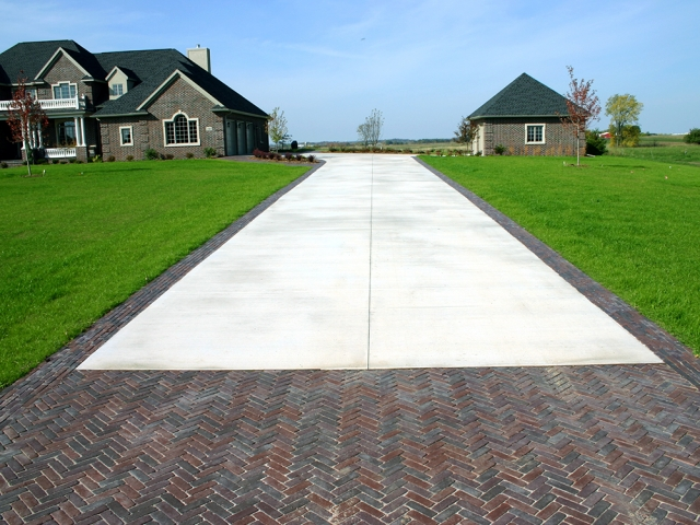 Large Concrete Driveway With Brick Border