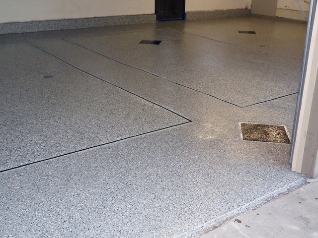 Resurfaced Garage Floor With Triangles and Parking Lines