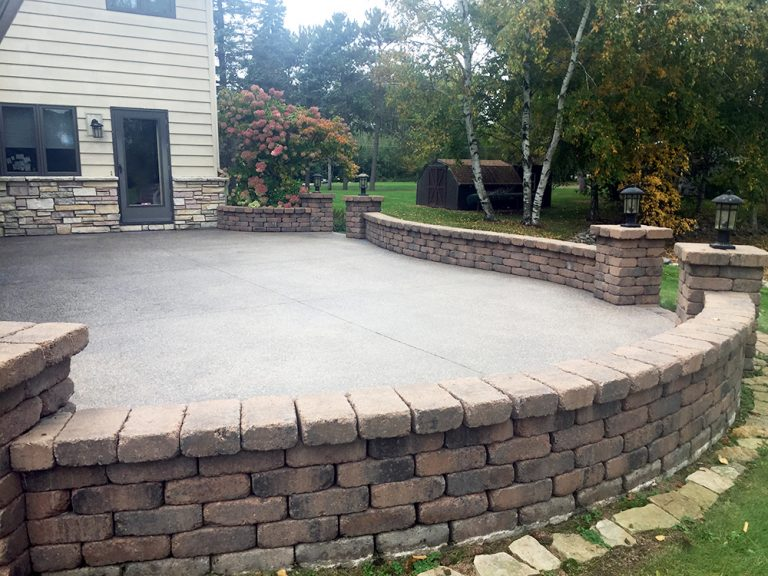Exposed Aggregate Patio With Seat Wall