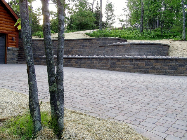 Tiered Retaining Walls and Brick Driveway